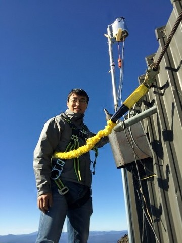 Co-author Lei Zhang wears a harness to access equipment at the Mount Bachelor Observatory in September 2015.