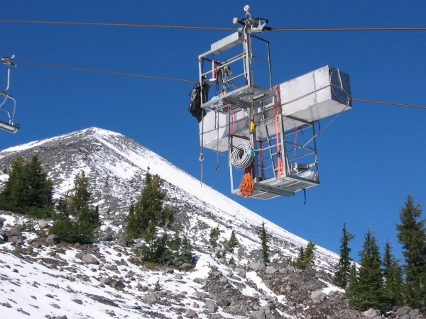 Researchers use the ski lifts to carry equipment to sample air on the summit. A radon sensor travels to the peak of Mount Bachelor.