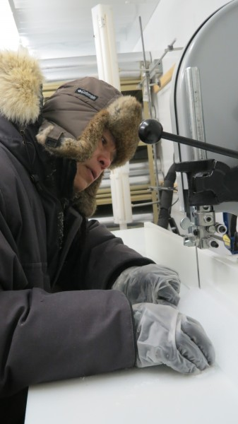 Using a special band saw, Cole-Dai slices off a piece of ice core from Western Antarctica. The specimens are stored at -4 degrees Fahrenheit in the SDSU Ice Core and Environmental Chemistry Lab freezer.