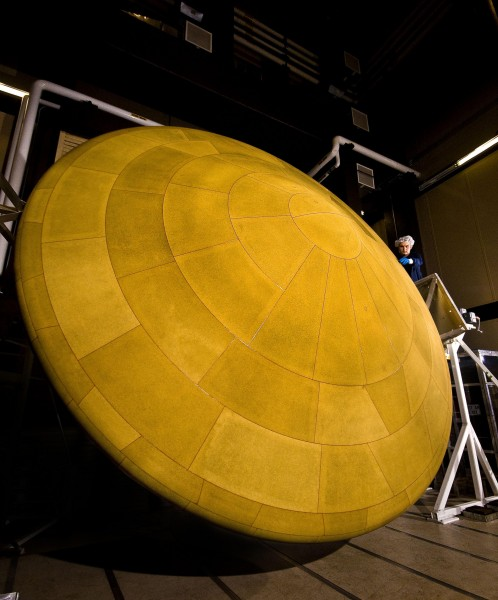 The saucer-like Mars Science Laboratory, which landed the Curiosity rover on MARS, featured the largest heat shield (pictured here)—at 14 feet 9 inches in diameter—to enter a planet's atmosphere. NASA is now engaging in R&D for even larger heat shields made of flexible, foldable material that can open up like an umbrella to protect spacecraft during atmospheric entry.