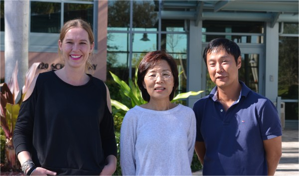 (Left to right) Research Associate Audrey Richard, Associate Professor Hyeryun Choe and Research Associate Byoung-Shik Shim led the study on the Florida campus of The Scripps Research Institute.