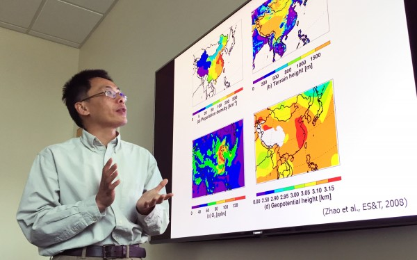 Georgia Tech Professor Yuhang Wang explains maps showing terrain, population density and other issues affecting haze formation in the East China Plains during winter months.