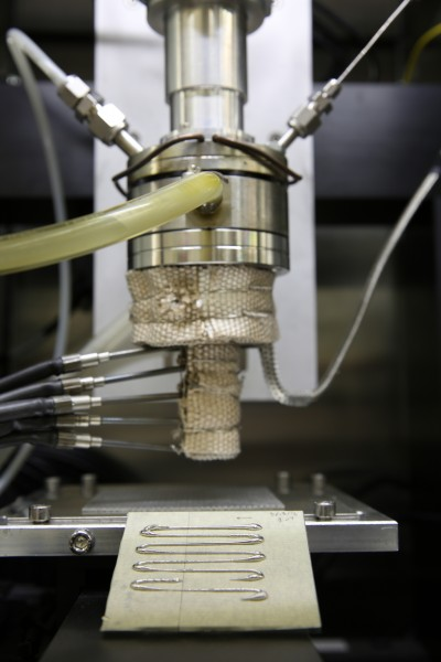 Unlike other metal 3D printing techniques that use lasers to fuse metal powder, the Direct Metal Writing approach incorporates an ingot that is heated until it reaches a semi-solid state before it's forced through a nozzle. As it cools, the material hardens to form a 3D metal structure.
