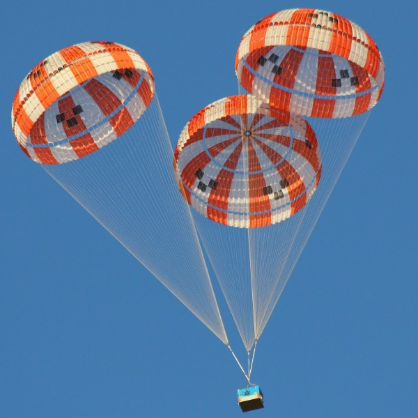 This array of parachutes, designed for NASA's Orion spacecraft, is seen here during a test above Eloy, Ariz., in 2015. Several parachute designs for Orion have also been tested in NASA wind tunnels.