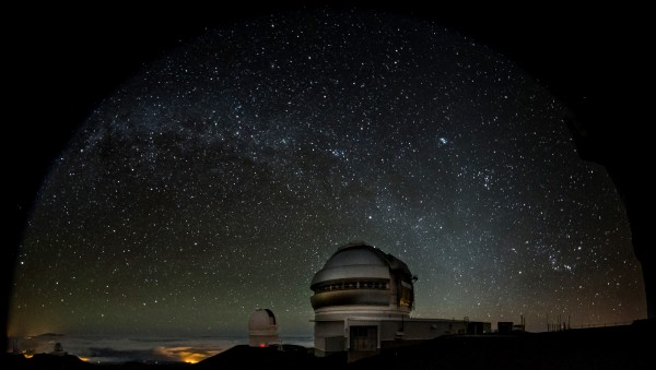 The Gemini North telescope (foreground, right) with the Canada-France-Hawaii Telescope in background (left). Image obtained during observations for Col-OSSOS and both telescopes are pointing at the same target.