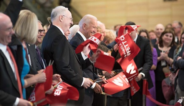Joe Biden (center) participates in the ribbon-cutting ceremony for the Fred & Pamela Buffett Cancer Center.