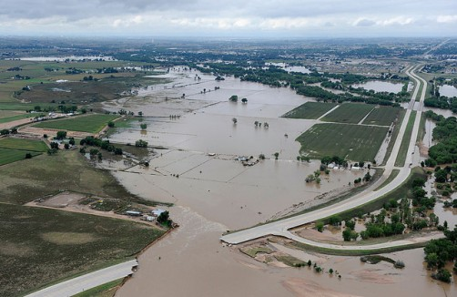 As a result of the flooding, the state lost approximately 500 miles of roadway and more than 30 bridges. Here, U.S. 34 in Greeley is breached by the South Platte River in flood stage.