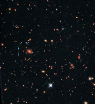 Newswise: Hubble Pushed Beyond Limits to Spot Clumps of New Stars in Distant Galaxy