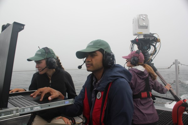 APL FSO operators check the monitors on Sea Hunter as a third operator monitors operations.