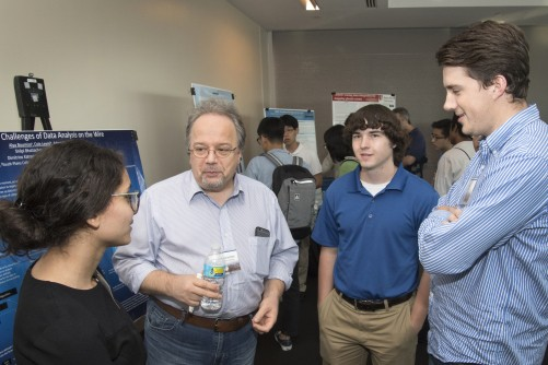 Mentor Dimitrios Katramatos with his students (left to right): Alya Boumiza, Adam Martin, and Cole Lewis.