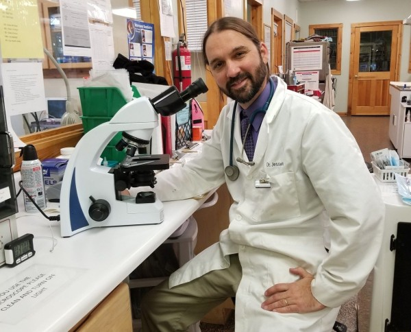 Jesse Fallon spent countless hours in the laboratory analyzing blood samples as they were shipped to Blacksburg from the Gulf of Mexico. Photo by Nicole Newman.