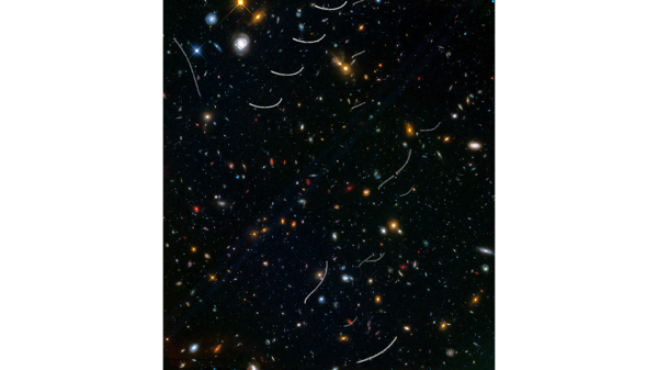 Some of our solar system's asteroids have photobombed deep images of the universe taken by NASA's Hubble Space Telescope. These asteroids reside, on average, only about 160 million miles from Earth-right around the corner in astronomical terms. Yet they've horned their way into this picture of thousands of galaxies scattered across space and time at inconceivably farther distances.  