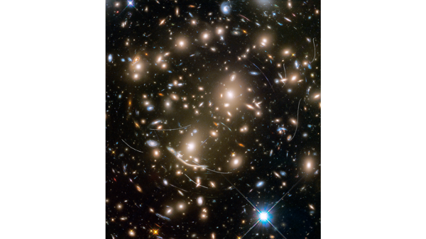 As if this Hubble Space Telescope picture isn't cluttered enough with myriad galaxies, nearby asteroids photobomb the image, their trails 