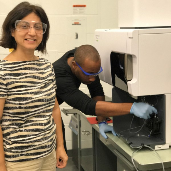 Analytical Chemist Lionel Mojekwu assists Environmental Engineer Meltem Urgun Demirtas on research for a new patent-pending biogas technology in the Energy Systems Division lab at Argonne.