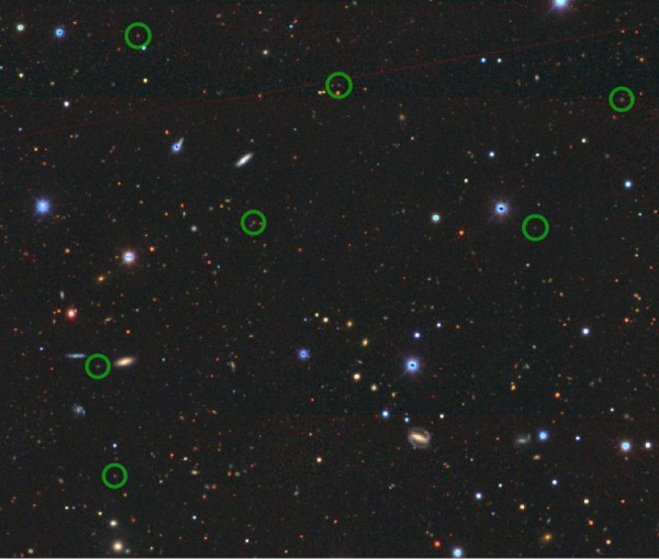 The image shows the location of some the emission line galaxies observed in the study (green circles) against the images of a big patch of the sky as observed by The Dark Energy Camera Legacy Survey (DECaLS) http://legacysurvey.org/decamls/