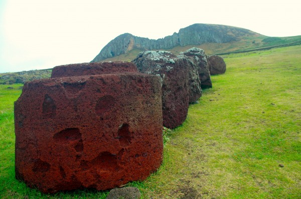 Pukao are large, cylindrical stones made from a volcanic rock known as 'red scoria.' Weighing multiple tons, they were placed on the heads of the moai during prehistoric times, consistent with the Polynesian traditions of honoring their ancestors.