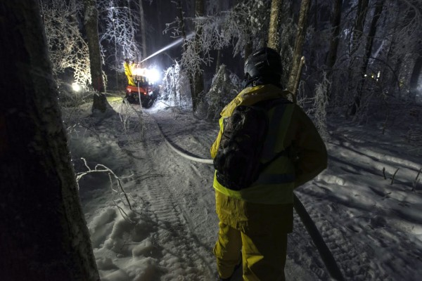 An ice storm technician helps out with night icing during an ice storm experiment at the Hubbard Brook Experimental Forest, NH.
