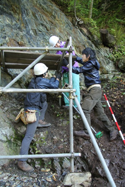 First author Kazumi Ozaki (r.) takes geological samples from layers of rock formed during the Great Permian Extinction. He is shown here with other researchers in Japan doing work unrelated to this study.