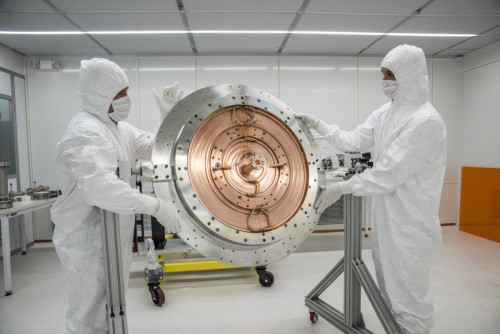 Joe Wallig, left, a mechanical engineering associate, and Brian Reynolds, a mechanical technician, work on the final assembly of the LCLS-II injector gun in a specially designed clean room at Berkeley Lab in August.