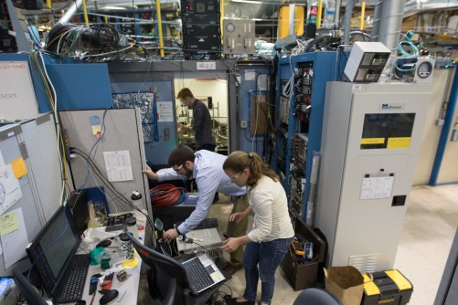 SLAC staff scientist Johanna Nelson Weker, front, leads a study on metal 3-D printing at SLAC's Stanford Synchrotron Radiation Lightsource with researchers Andrew Kiss and Nick Calta, back.