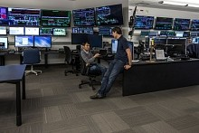 From left, SLAC's Yauntao Ding and Marc Guetg discuss their work at the lab's Accelerator Control Room where beams that feed the X-ray laser are monitored.