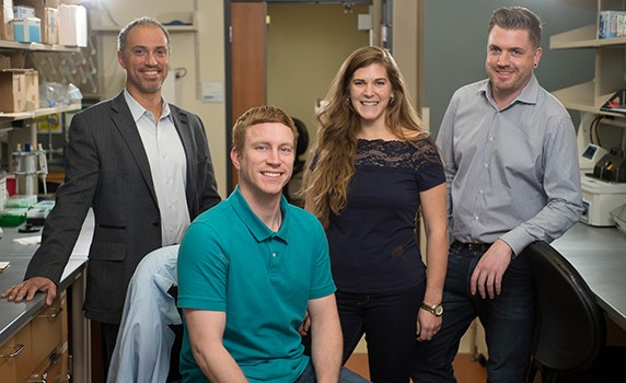 Tristan Raisch and Carissa James (center) have been awarded two-year fellowships from the National Institutes of Health to pursue cardiovascular research at the Virginia Tech Carilion Research Institute. Mentors Steven Poelzing (left) and James Smyth (right) lead research programs at the VTCRI Center for Heart and Regenerative Medicine Research.