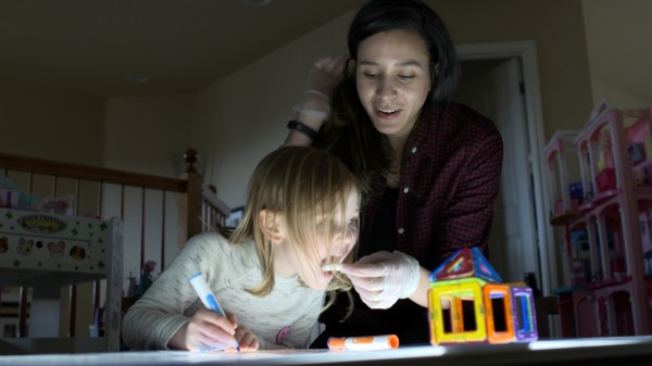 CU Boulder researcher Lameese Akacem takes a melatonin sample from a preschooler.