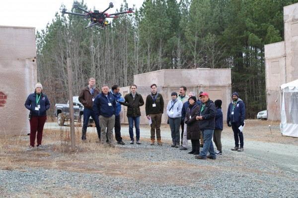 Participants watch a drone in action.