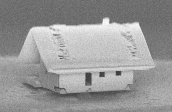 A microhouse's tiled roof shows the ion gun's new ability to focus on a 300-by-300-micrometer area.