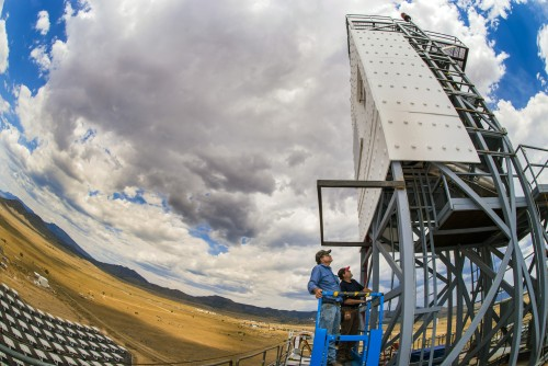 Technologists John Kelton (retired), left, and Daniel Ray perform inspections of the falling-particle receiver during a cloud delay atop the National Solar Thermal Test Facility's Solar Tower at Sandia National Laboratories.