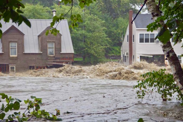 Floodwaters from Tropical Storm Irene, which swept across Vermont in August 2011, causing historic flooding and damage. As extreme weather events increase, new research from UVM suggest more people may turn to ecologically friendly practices to manage stormwater.