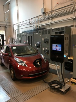 The new electric vehicle fast charger (shown on right) is at least 10 times smaller than existing systems and wastes 60 percent less power during the charging process, without sacrificing the charging time.
