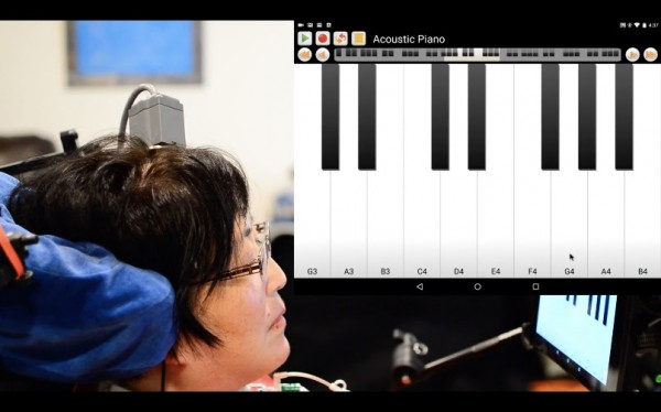 A participant in the BrainGate clinical trial directly controls a tablet computer through a brain-computer interface. The participant, a musician, played a snippet of