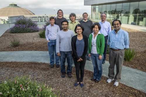 Berkeley Lab researchers (front row, from left) Iris Young, Sheraz Gul,  Ruchira Chatterjee, Junko Yano, Vittal Yachandra, (back, from left) Nigel Moriarty, Jan Kern, Aaron Brewster, Nicholas Sauter have captured the most complete images of photosynthesis in action.